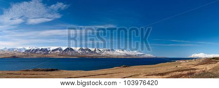 View of Iceland Snowcapped mounaitns  over lake fjord panorama