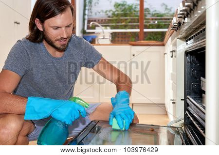 male doing household chores in the kitchen
