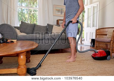Caucasian male doing domestic chores at home