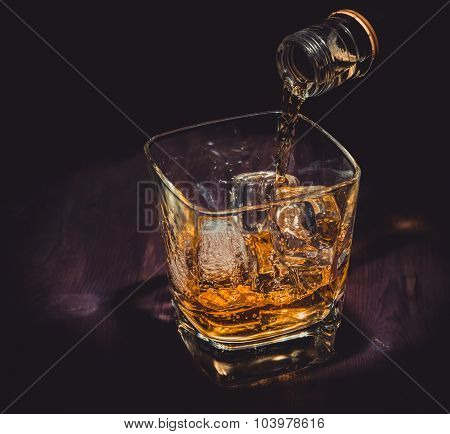 Barman Pouring Whiskey In The Glass On Wood Table, Warm Atmosphere, Old Western Style, Time Of Relax
