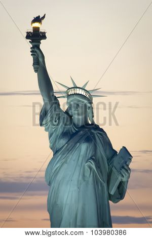 Statue Of Liberty In New York At Sunset