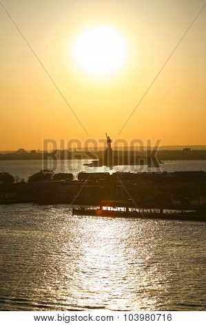 Liberty Statue And Sunset In New York