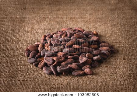 Pile Of Raw Cocoa Beans On Sacking