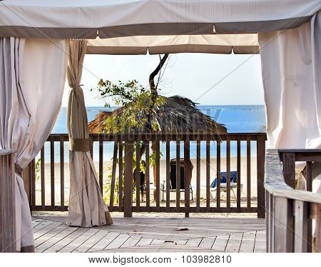 Pavilion in natural style on a beach