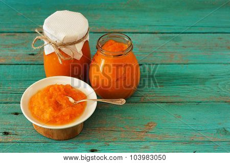 Homemade Yummy Pumpkin Jam In Glass Jars And In White Plate With Silver Spoon On Wooden Table Copysp