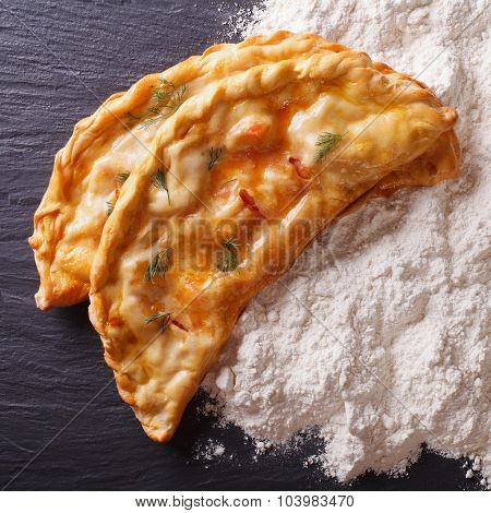 Italian Food: Pizza Calzone And Flour Close-up. Top View