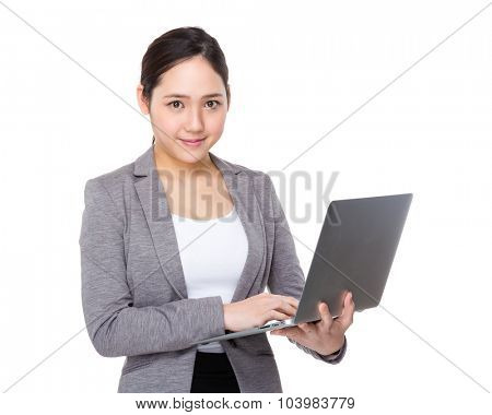 Asian young Businesswoman use of the laptop computer