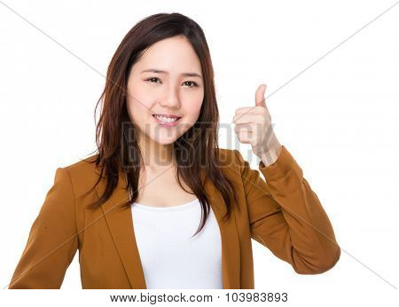 Asian businesswoman showing thumb up gesture