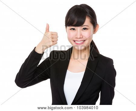 Businesswoman showing thumb up gesture