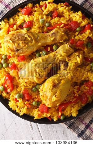 Paella With Chicken And Vegetables Close-up. Vertical Top View