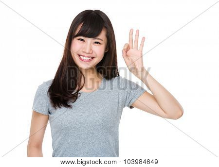 Asian Young Woman with ok sign gesture