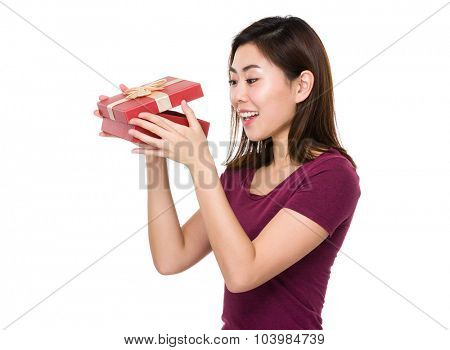 Asian young woman looking into the gift box