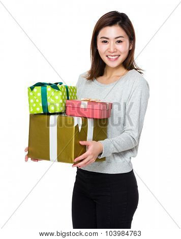 Young woman hold with lots of present box