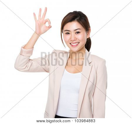 Asian businesswoman showing ok sign gesture