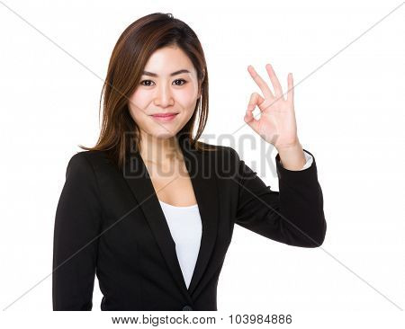 Businesswoman with ok sign gesture