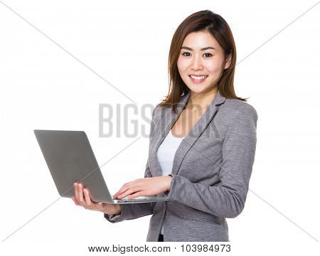 Businesswoman use of the notebook computer
