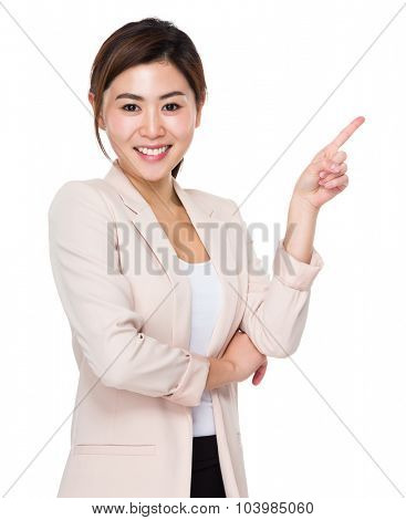 Businesswoman showing finger point up