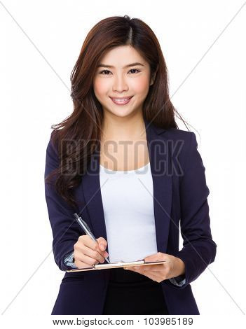 Young asian businesswoman take note on clipboard