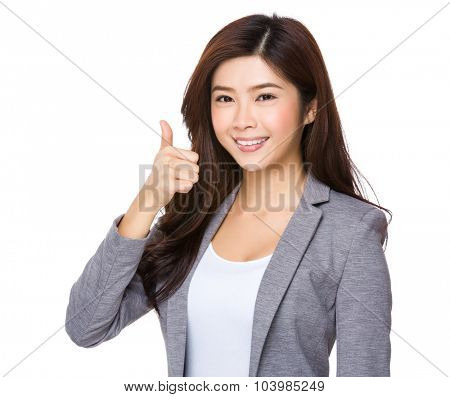 Asian young businesswoman showing thumb up