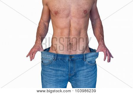 Midsection of a man showing loose denim jeans over white background
