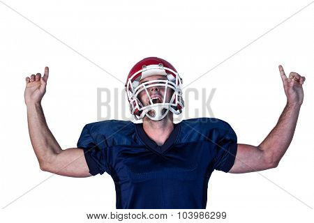 Rugby player celebrating while pointing up over white background