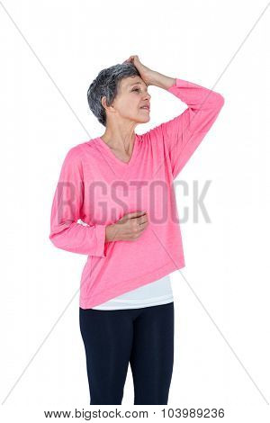 Mature woman suffering from headache against white background