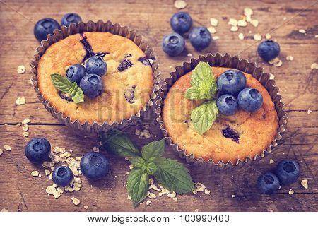Blueberry muffins in old metal cupcake holder