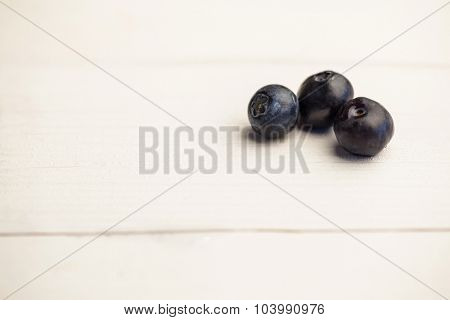 Fresh blueberries in close up on wooden table