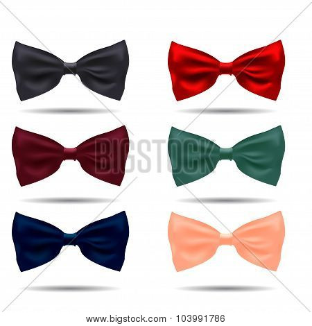 Vector set of silk bow ties on a background.