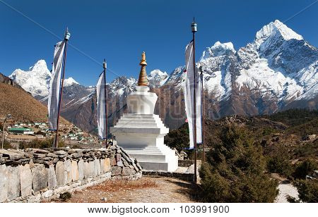 White Stupa, Prayer Flags And Himalayas