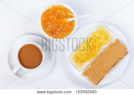 Sandwiches With Orange Marmalade,a Cup Of Coffee
