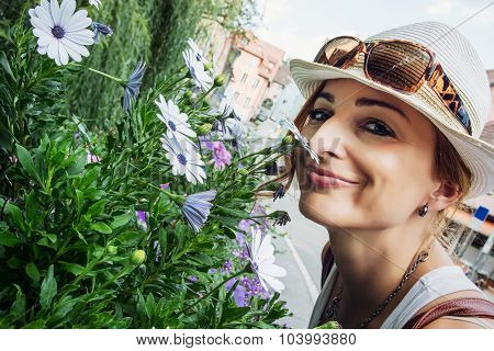 Young Caucasian Woman Sniff Beautiful Flowers