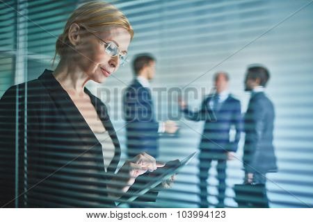 Businesswoman with touchpad working in office
