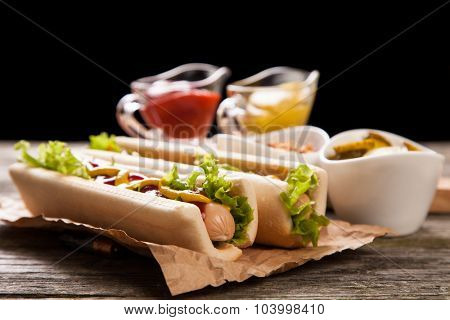 Hot dogs on old wooden background