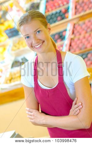 Young female supermarket worker
