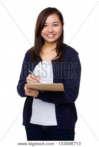 Asian woman take note on clipboard