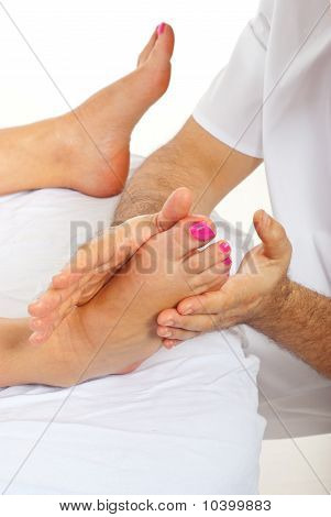 Masseur Massaging Woman Feet