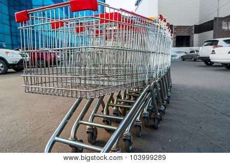 Set of supermarket trolleys on mall parking lot