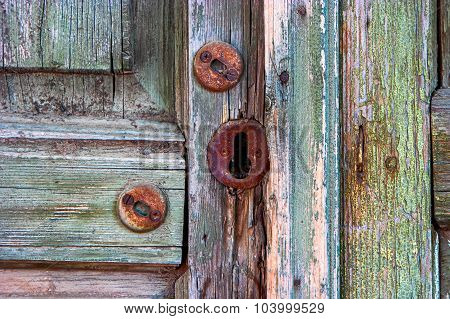 Old wooden door and rusty keyhole in Astrakhan, Russia