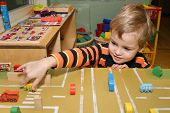 foto of nursery school child  - child play in kindergarten street car toys - JPG