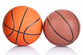 Постер, плакат: Two basketballs isolated on a white background