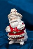 image of nick-nack  - Antique porcelain Santa Claus on lace - JPG