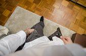 ������, ������: Man dressing putting pants on Self POV