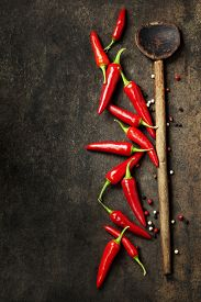 picture of red hot chilli peppers  - Vibrant red mexican hot chilli pepper on old background - JPG