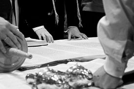 stock photo of torah  - ceremony reading the parchment Torah scroll with a man - JPG