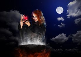 picture of cauldron  - Young witch with red potion and cauldron on night sky background - JPG