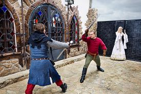 pic of struggle  - Medieval struggle for a woman in the castle yard - JPG