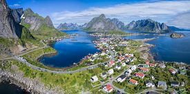 stock photo of reining  - Scenic panorama of fishing port Reine on Lofoten islands in Norway popular tourist destination - JPG