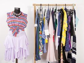 stock photo of chevron  - Wardrobe with clothes and accessories - JPG