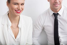 stock photo of office romance  - Young employees and secret romance in office - JPG